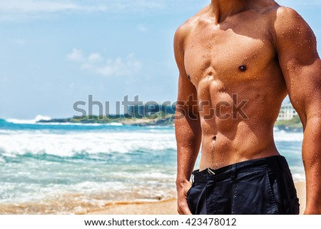 Masculine hard body at the beach