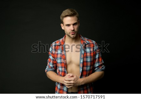 Masculine traits concept. Male fashion and beauty. Sexy muscular macho. Athlete man undressing. Muscular guy. Man confident face taking off shirt. Full of desire. Perfect body. Muscular chest.
