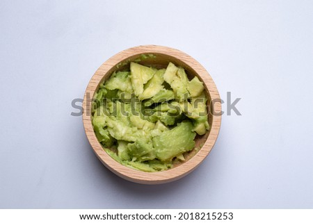 mashed avocado in a wooden cup on white background Foto stock ©