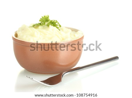 Mashed potato with parsley in the bowl isolated on white