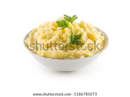 Mashed potatoes in bowl isolated on white background.