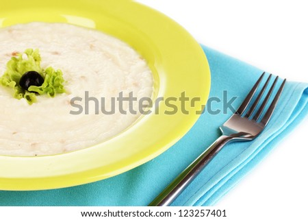 Mashed potatoes in green plate isolated on white