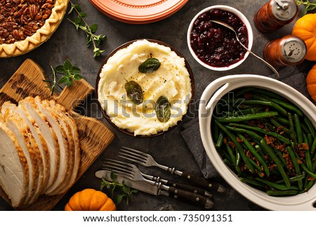 Mashed potatoes with butter and sage, side dish for Thanksgiving or Christmas dinner overhead shot
