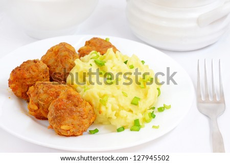 Mashed potatoes with noisettes on a table