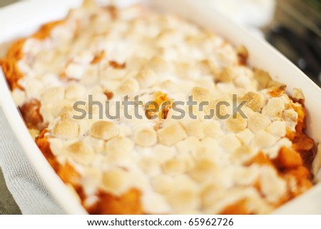 Mashed sweet potatoes with a marshmallow topping.