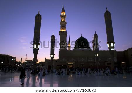 Masjid (Mosque) Nabawi at sunset in Al Madinah, Kingdom of Saudi Arabia.