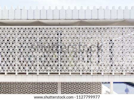 Masjid Negara, Kuala Lumpur. Beautiful facade of islamic mosque with structural, geometric pattern in white. Architectural modern gem, landmark in Malaysia creates a geometrical textured background #1127799977