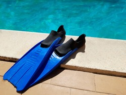 Mask and flippers in a swimming pool. Swim items (Masks and fins)