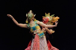 mask dance performances about the story of the Ramayana. The love story of Rama and Sinta in Javanese traditional dance. Two Javanese dancer movements on the stage performance