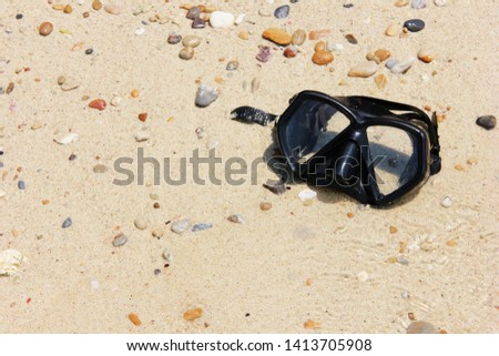 Mask for scuba diving lies on the sand. Tourism and active rest on the sea. #1413705908