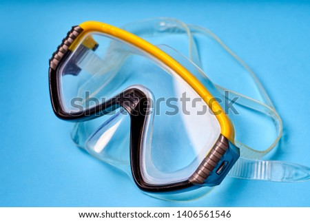 Mask for scuba diving on an blue background. #1406561546