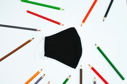 mask with pencils on a white background