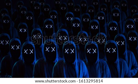 Masked hackers army. Dangerous hooded group of hackers. Internet, cyber crime, cyber attack, system breaking and malware concept. Dark face. Anonymous.