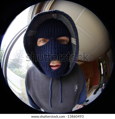 Masked man   in fish eye view - stock photo