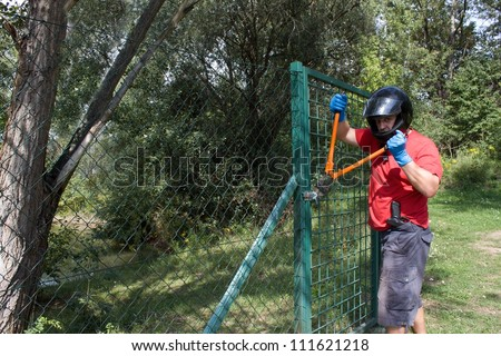 Masked robber opens the lock, Bolt Cutters
