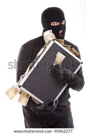 masked robbers with a suitcase full of money with an aggressive expression on his face