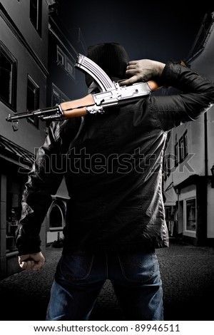 masked terrorist with a kalashnikov submachine gun - stock photo