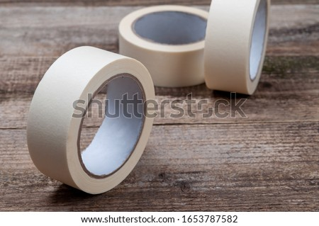 Masking tape on wooden background. Rolls of tape closeup view. Photo stock ©