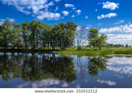 Maskinonge River Quebec Canada landscape in summer with a beautiful blue sky