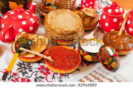 Maslenitsa festival meal - pancake with caviar and tea