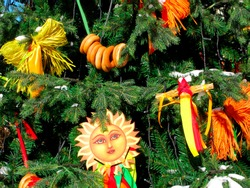 Maslenitsa in Russia. Decorations of Slavic holiday. On fir tree are dolls, bagels and festive symbol of Shrovetide - the sun. The ancient Slavs staged Shrovetide in honor of the pagan Sun god.