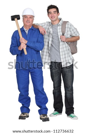 Mason and young man - stock photo