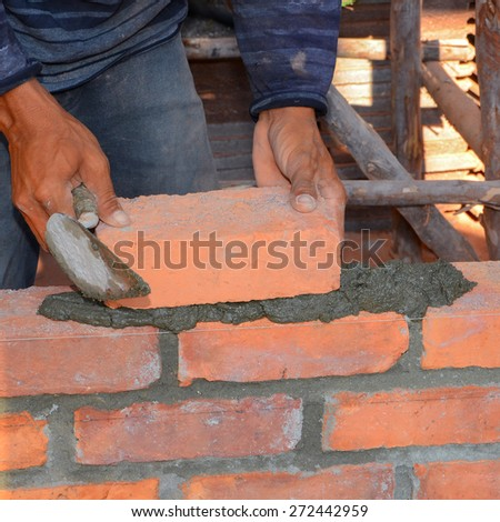Mason brick walls were formed by using the work placement is patterned brick alternating rows up from the floor up.