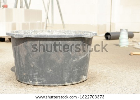 mason bucket and building stones on construction site