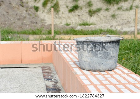 mason bucket on construction site on building stones