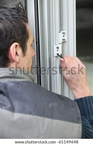 Mason fixing a door