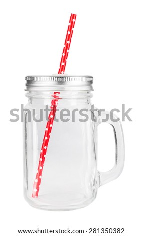 Mason jar with red paper straw isolated on white background.