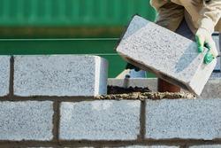 Mason on laying bricks.HOME BUILDING & RENOVATION