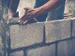 Mason or Brick builders are building walls in Thailand