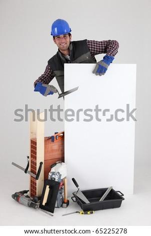Mason with construction equipment