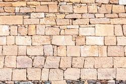 Masonry stone wall, yellow stone