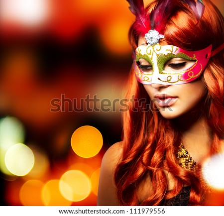 Masquerade. Beautiful Girl in a Carnival mask over Holiday Blinking Background. Bokeh