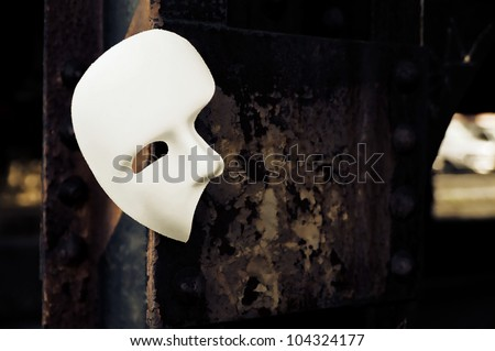 Masquerade - Phantom of the Opera Mask on Rusty Bridge Column