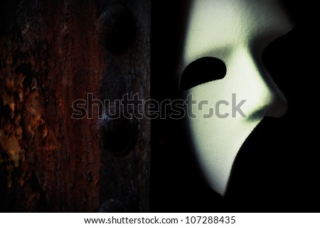 Photo of  Masquerade - Phantom of the Opera Mask on Rusty Bridge Column
