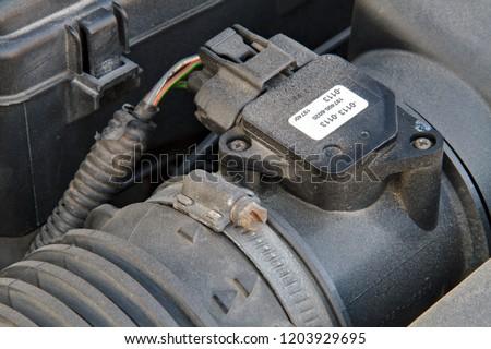 Mass air flow sensor of a car at the air filter housing.