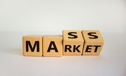 Mass market symbol. Turned wooden cubes with words 'mass market'. Beautiful white background, copy space. Business and mass market concept.
