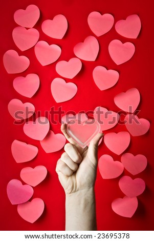 Mass of red post-it papers shaped like Valentine's hearts - stock photo