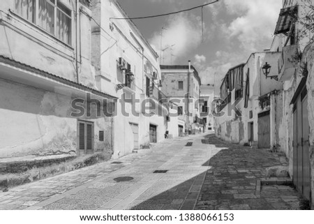 Massafra and its ravines. Houses built in the rock. Puglia in Black and White. Italy