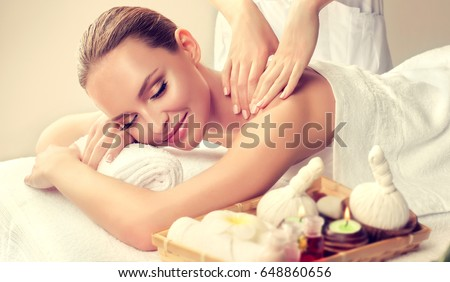 Massage and body  care. Spa body massage treatment. Woman having massage in the spa salon for beautiful girl  #648860656