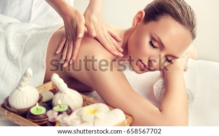 Massage and body  care. Spa body massage treatment. Woman having massage in the spa salon . Massage woman hands