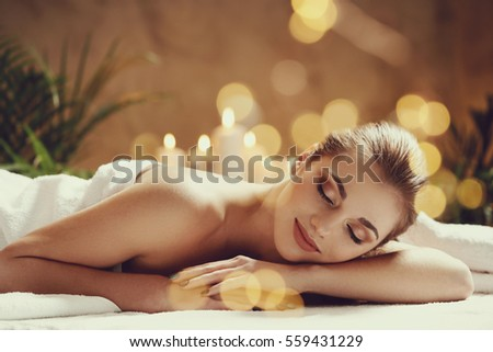 Massage. Beautiful girl in spa salon - Shutterstock ID 559431229