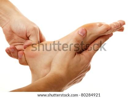 massage foot female close-up isolated on white background