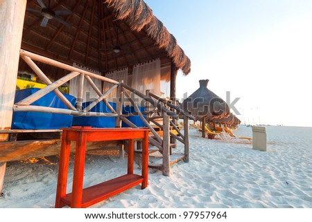 Massage hut on Caribbean beach at sunrise