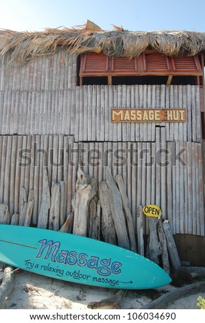 Massage hut with surfboard sign