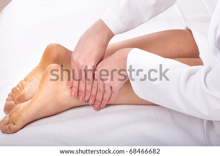 Massage of female leg. Health and beauty.