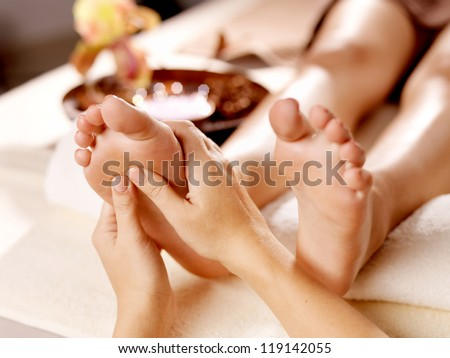 Massage of human foot in spa salon Soft focus image